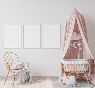 Interior mock up frame in newborn bedroom, three white frames on bright background with rattan crib and chair. Scandinavian baby room design