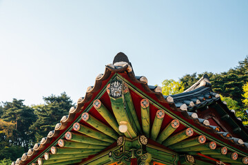 Korean traditional wooden roof eaves at Seoknamsa temple in Anseong, Korea