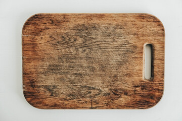 Old wooden cutting board on a white background. Top view. Copy, empty space for text