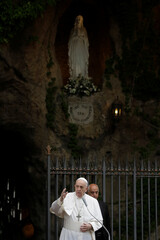 Pope Francis delivers his blessing at the end of a rosary, amid the spread of coronavirus disease (COVID-19), in Vatican gardens