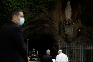 Pope Francis prays during a rosary, amid the spread of coronavirus disease (COVID-19), in Vatican gardens