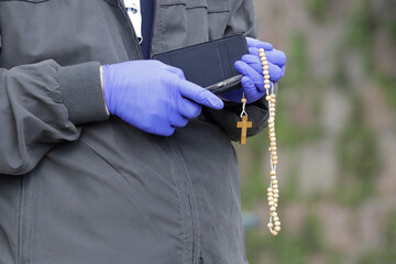 A man wearing a gloves prays during a rosary led by  Pope Francis , amid the spread of coronavirus disease (COVID-19), in Vatican gardens