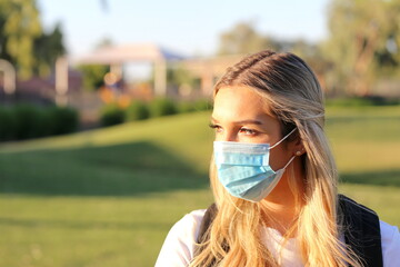 A portrait of a student wearing a face mask.