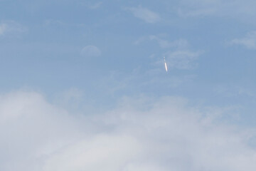 A SpaceX Falcon 9 rocket with the company's Crew Dragon spacecraft onboard lifts off from Kennedy Space Center