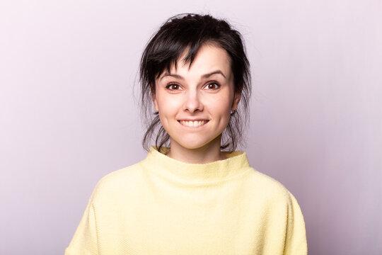 beautiful girl in a yellow sweater