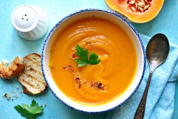 Delicious autumn pumpkin soup. Top view with copy space.