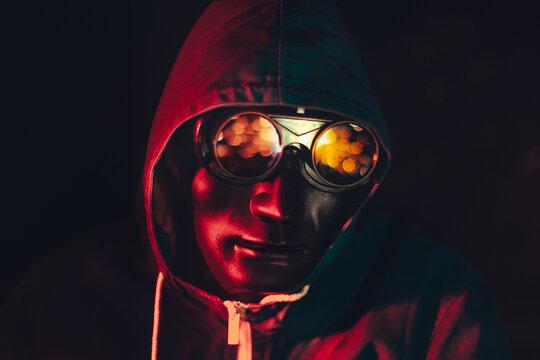 masked hacker man in glasses