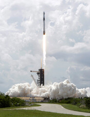 A SpaceX Falcon 9 rocket and Crew Dragon spacecraft carrying NASA astronauts Douglas Hurley and Robert Behnken lifts off