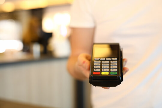 Man holds commercial portable banking terminal