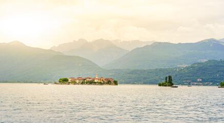Isola dei Pescatori - fisherman island in Maggiore lake with mountains in the background, Borromean Islands (Isole Borromee), Stresa, Piedmont, Northern Italy - travel destination in Europe.