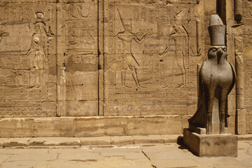 Hawk statue and hieroglyphics in the Edfu temple