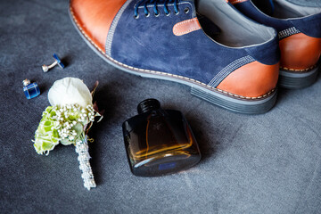 Blue cufflinks, boutonniere, toilet water and groom's shoes Wall mural