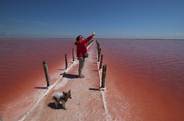 A woman takes a selfie at a salt production site on the bed of a drained area of the Sasyk-Sivash lake near Yevpatoria