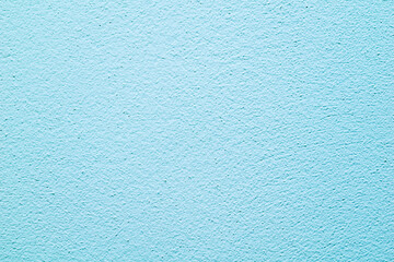 wall painted in blue with visible plaster texture