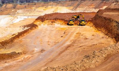 Big truck works at quartz sand quarry