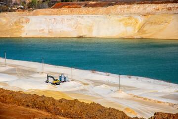quartz white sand quarry with blue lake
