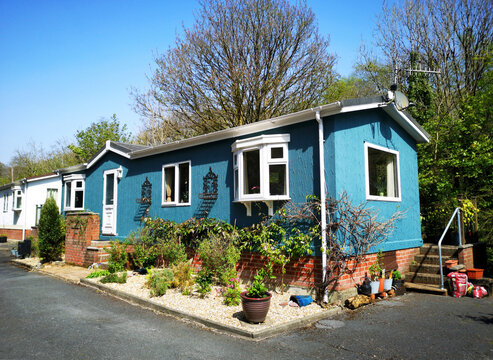 Swansea, UK: April 27, 2019: Residential mobile homes for retired persons only with gardens and car parking spaces. Illustrative Editorial