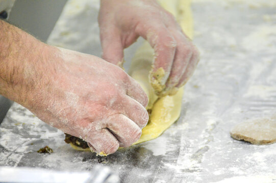 A chef preparing maultaschen or traditional german dumplings at a restaurant kitchen