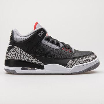 VIENNA, AUSTRIA - FEBRUARY 19, 2018: Nike Air Jordan 3 Retro OG black, grey and red sneaker on white background.