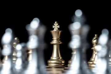gold against silver chess pieces team on chess board, business strategy concept