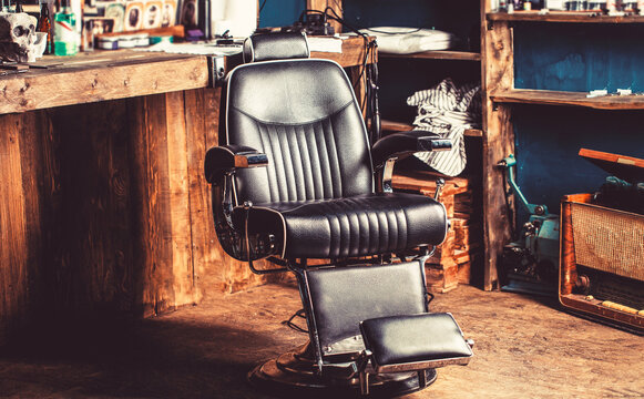 Barber shop chair. Barbershop armchair, modern hairdresser and hair salon, barber shop for men. Stylish vintage barber chair. Professional hairstylist in barbershop interior