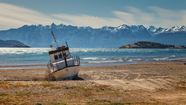 boat aground on the beach of the General Carrera lake, Chilean Patagonia