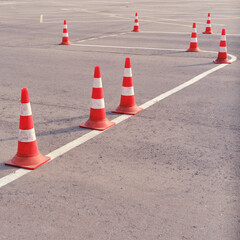 Orange traffic cones on a site in a driving school and parallel parking