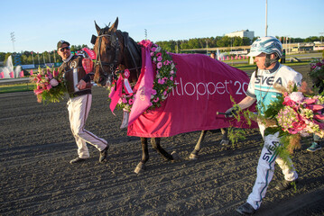 The trainer Daniel Reden, the horse Propulsion and driver Orjan Kihlstrom celebrate winning the finals of the Elitloppet trotting event at Solvalla track without an audience due to the coronavirus disease (COVID-19) outbreak, in Stockholm
