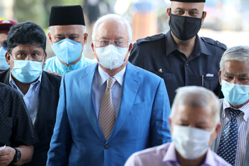 Former Malaysian Prime Minister Najib Razak and his supporters arrive at Kuala Lumpur High Court in Kuala Lumpur