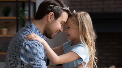 Keuken foto achterwand Texturen Happy loving young dad hug play with excited little daughter and home, smiling caring father engaged in funny game activity, enjoy family weekend with overjoyed small preschooler girl child
