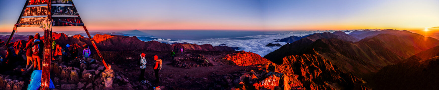 On the summit of Jebel Toubkal, highest mountain in Morocco during sunrise.