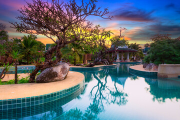 Koh Kho Khao, Thailand - November 5, 2012: Tropical pool scenery of the Andaman Princess Resort & SPA at sunset. This beautiful hotel was destroyed by tsunami in 2004 and rebuild, Thailand.