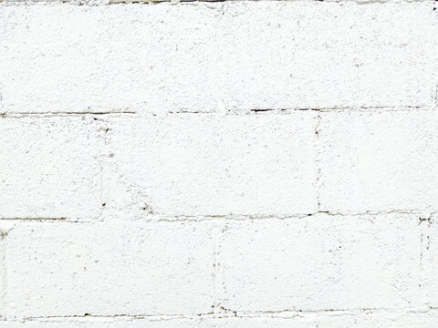 fond de mur en parpaing blanc