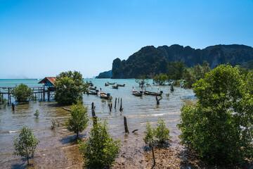 Old longtail boats off Krabi coast