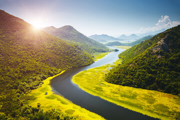 Wall Mural - The charming valley of the Rijeka Crnojevica on a sunny day. Location place National park Skadar Lake, Montenegro.