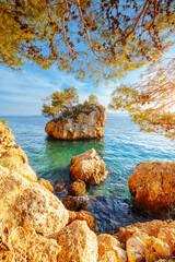 Wall Mural - Attractive small islet on Punta Rata beach in Brela. Location place Makarska riviera, Croatia, Dalmatia region, Balkans, Europe.