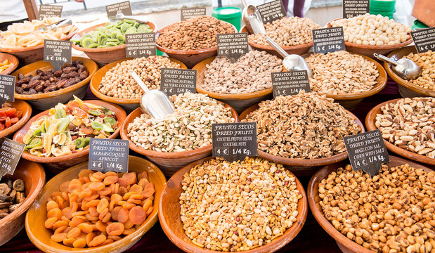 Selection of dried fruits and nuts for sale at Sineu market, Mallorca, Spain.