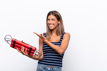 Poster Palm tree young pretty woman smiling cheerfully, feeling happy and showing a concept in copy space with palm of hand with a dynamite bomb