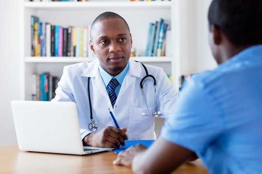 African american male doctor listening to infected patient