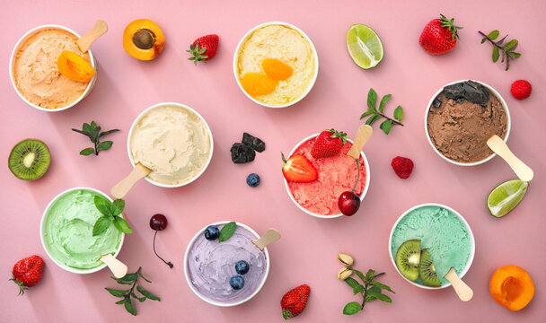 Various colorful ice cream sorts with fruits in paper cups