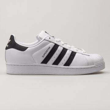 VIENNA, AUSTRIA - AUGUST 13, 2018: Adidas Superstar white and black sneaker on white background.