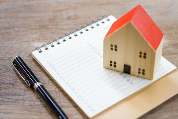 House Models and Book list. Check the quality in the home. Concept of buying a new home .Home inspection for maintenance Repair and Construction with copy space for your text or design.