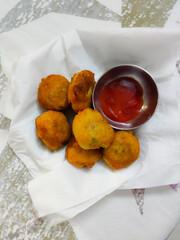 fried potato vada with tomato sauce