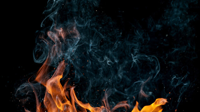 fire flames with sparks on a black background, close-up