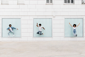 Three friends jumping together in the air