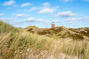Wall Mural - Rotes Kliff Lighthouse on the island of Sylt, Schleswig-Holstein, Germany