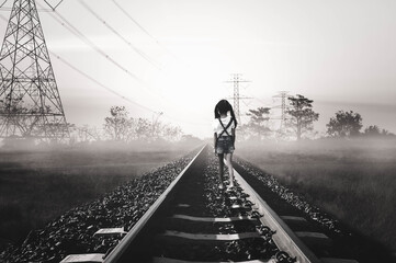 man walking on railroad tracks