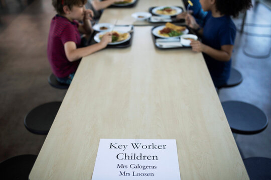 Children of key workers eat their lunch at St Dunstan's College junior school as some schools re-open following the outbreak of the coronavirus disease (COVID-19) in London