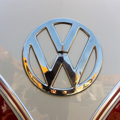 Logo of the Volkswagen VW car brand on the front of an old-timer bus Bully in Braunschweig, Germany, April 7., 2019