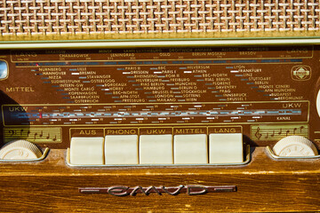 Close-up of an old analog tube radio from Emud electric Company with the station displays of the European radio stations